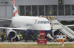 © Licensed to London News Pictures. 10/10/2019. London UK: Security officials and fire officers surround an Extinction Rebellion activist who has glued himself to the top of an aircraft at London City airport. Police are stopping protesters from shutting down the airport as their campaign enters its forth day , Photo credit: Steve Poston/LNP
