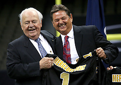 04 October 2011. New Orleans, Louisiana, USA.  <br /> NFL's New Orleans Saints announce a multi million dollar deal with Mercedes-Benz for naming rights on the Louisiana Superdome. Now the Mercedes-Benz Superdome. L/R Saints owner Tom Benson and Mercedes-Benz USA President and CEO Ernst Leib, <br /> Photos; Charlie Varley/varleypix.com