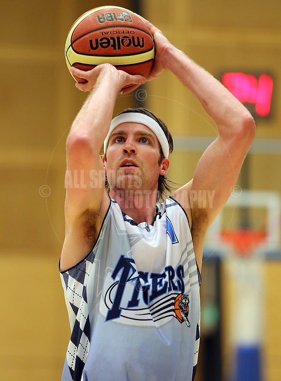 PERTH, AUSTRALIA - JULY 16: Rob Kampman of the Tigers shoots a free throw during the week 18 SBL game between the Perry Lakes Hawks and the Willetton TIgers at The State Basketball Center on July 16, 2011 in Perth, Australia.  (Photo by Paul Kane/Allsports Photography)