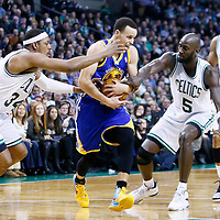 01 March 2013: Golden State Warriors point guard Stephen Curry (30) is fouled by Boston Celtics power forward Kevin Garnett (5) and Boston Celtics small forward Paul Pierce (34) during the Boston Celtics 94-86 victory over the Golden State Warriors at the TD Garden, Boston, Massachusetts, USA.