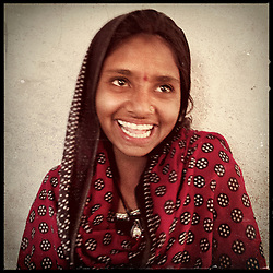 """iPhone portrait of Ashu Kumari, 12, in a village outside of Banswara, Rajasthan, India, April 5, 2013. """"I would not feel good if I got married at a young age. I would not feel good having a child at a tender age. I would not feel good if my children were born while I am still a girl,"""" said Kumari. <br />  <br /> Under Indian law, children younger than 18 cannot marry. Yet in a number of India's states, at least half of all girls are married before they turn 18, according to statistics gathered in 2012 by the United Nations Population Fund (UNFPA). However, young girls in the Indian state of Rajasthan—and even a few boys—are getting some help in combatting child marriage. In villages throughout Tonk, Jaipur and Banswara districts, the Center for Unfolding Learning Potential, or CULP, uses its Pehchan Project to reach out to girls, generally between the ages of 9 and 14, who either left school early or never went at all. The education and confidence-building CULP offers have empowered youngsters to refuse forced marriages in favor of continuing their studies, and the nongovernmental organization has provided them with resources and advocates in their fight."""