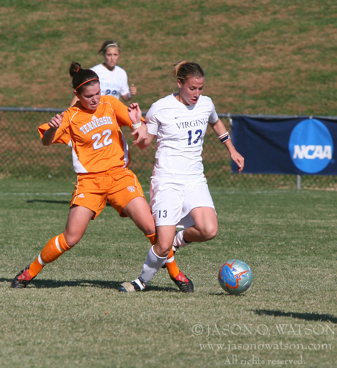 Noelle Keselica (13) is tripped from behind by Tennessee's Ali Christoph (22). Keselica had two assists as UVA eliminated UT from the NCAA tournament by winning 3-0.