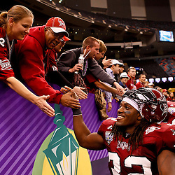 December 18, 2010; New Orleans, LA, USA; Troy Trojans running back DuJuan Harris (32) celebrates with fans following a win over the Ohio Bobcats in the 2010 New Orleans Bowl at the Louisiana Superdome. Troy defeated Ohio 48-21. Mandatory Credit: Derick E. Hingle