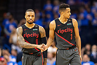 OKLAHOMA CITY, OK - APRIL 21: Damian Lillard #0 shakes hands with CJ McCollum #3 of the Portland Trail Blazers during a game against the Oklahoma City Thunder during Round One Game Three of the 2019 NBA Playoffs on April 21, 2019 at Chesapeake Energy Arena in Oklahoma City, Oklahoma  NOTE TO USER: User expressly acknowledges and agrees that, by downloading and or using this photograph, User is consenting to the terms and conditions of the Getty Images License Agreement.  The Trail Blazers defeated the Thunder 111-98.  (Photo by Wesley Hitt/Getty Images) *** Local Caption *** Damian Lillard; CJ McCollum