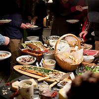 Guests enjoy the fest at Nanna Rögnvaldardóttir's  December 23rd buffett photographed on December 23 buffet  at her home in Reykjavik, Iceland, December 23, 2013.