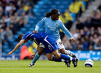 Photo: Jed Wee.<br /> Manchester City v Everton. The Barclays Premiership.<br /> 02/10/2005.<br /> <br /> Manchester City's Kiki Musampa (R) shoves aside a challenge from Everton's Leon Osman.