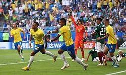Brazil's Neymar (left) celebrates scoring his side's first goal of the game