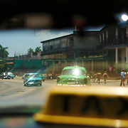 The streets of Havana seen through am old shared taxi