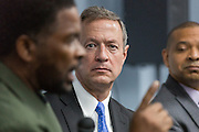 Former Maryland Governor and Democratic presidential candidate Martin O'Malley (rights) listens to South Carolina Rep. Wendell Gilliard during a discussion on gun violence at Mt. Moriah Baptist Church October 22, 2015 in North Charleston, South Carolina.