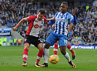 Football - 2017 / 2018 Premier League - Brighton & Hove Albion vs. Southampton<br /> <br /> Cedric of Southampton clears from Sofiane Boufal of Brighton at The Amex.<br /> <br /> COLORSPORT/ANDREW COWIE