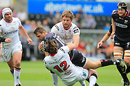 Dan Biggar of the Ospreys © is stopped by Ulster's Stuart McCloskey (12) and Iain Henderson. Guinness Pro12 rugby match, Ospreys v Ulster Rugby at the Liberty Stadium in Swansea, South Wales on Saturday 7th May 2016.<br /> pic by  Andrew Orchard, Andrew Orchard sports photography.