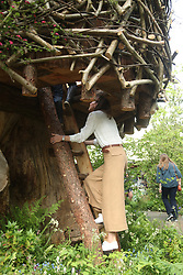 The Duchess of Cambridge climbs the ladder into the treehouse during a visit to her garden at the RHS Chelsea Flower Show at the Royal Hospital Chelsea, London.