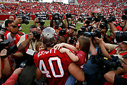 Tampa Bay Buccaneers running back Mike Alstott holds daughter Hannah in front of a throng of photographers during the Seattle Seahawks 23-7 victory over the Tampa Bay Buccaneers on December 31, 2006 at Raymond James Stadium in Tampa, Florida.