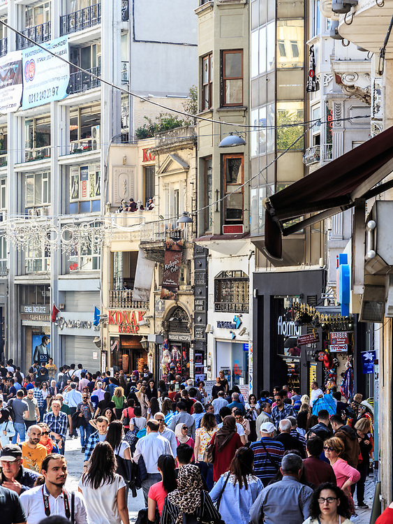 A hot and hectic day on İstiklal Avenue in Istanbul, Turkey. Located in the historical Beyoğlu (Pera) district, it is an elegant pedestrian street, 1.4 kilometers long, which houses boutiques, music stores, bookstores, art galleries, cinemas, theatres, libraries, cafés,   historical patisseries, and restaurants.