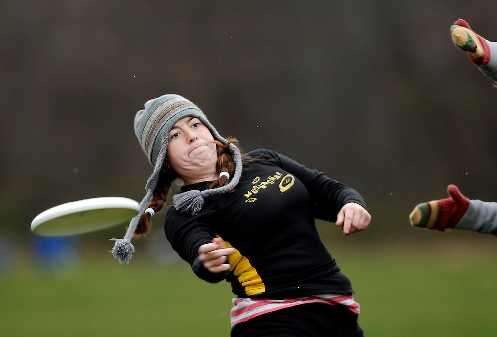 """With temperatures in the 30s, high winds and snow flurries, Saturday's ultimate Frisbee tournament was anything but hospitable. For Beth Aubuchon, however, it could have been a whole lot worse.<br /> <br /> This is the biggest year yet for the tournament. Twenty-two women's teams from around the country are spread out over Hinkson and Epple fields. Cheers echo off the frozen landscape.<br /> <br /> """"We're more competitive than people realize,"""" Beth says. """"You run hard, you throw hard.""""<br /> <br /> So far this tournament, nobody on her team, the MUchachas, has been injured. Knee injuries are the most common, but last year Beth broke a finger. Her pinkie still sticks out at an uncomfortable angle.<br /> <br /> """"This is truly a team sport,"""" Beth says. """"You have to rely on each other to score. One person can't win the game.""""<br /> <br /> After each catch, a player has 10 seconds to throw to a teammate and can only pivot as a defender tries to block the throw. On the field, Beth moves around making passes and catches with hands bare to the freezing temperatures. It's too hard to grip with gloves on.<br /> <br /> On the sidelines, the team huddles under blankets. """"I love my Frisbee family,"""" Beth says, hugging a teammate.<br /> <br /> Their next opponent is late to the field. Beth hangs out on the sidelines as seven of her teammates line up in the end zone to begin assessing points. For each five minutes the other team doesn't show, the MUchachas get a free point. These are the easiest points they've scored all weekend.<br /> <br /> They shiver in the high wind. Eating bananas and granola bars, they laugh and fidget to stay warm.<br /> <br /> """"Have we scored yet?""""<br /> <br /> Beth checks the time. """"Not yet!"""" she yells back.<br /> <br /> """"Can I get a sub?"""" comes the reply.<br /> <br /> """"OK,"""" Beth says, """"but I'm bringing the Coco Puffs."""""""