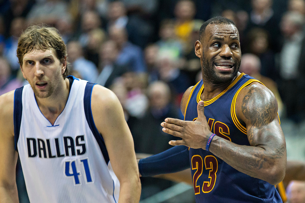 DALLAS, TX - JANUARY 12:  Lebron James #23 of the Cleveland Cavaliers instructs his teammates while guarding by Dirk Nowitzki #41 and Chandler Parsons #25 of the Dallas Mavericks at American Airlines Center on January 12, 2016 in Dallas, Texas.  NOTE TO USER: User expressly acknowledges and agrees that, by downloading and or using this photograph, User is consenting to the terms and conditions of the Getty Images License Agreement.  The Cavaliers defeated the Mavericks 110-107.  (Photo by Wesley Hitt/Getty Images) *** Local Caption *** Lebron James; Dirk Nowitzki; Chandler Parsons