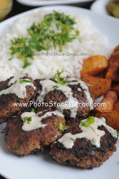fried Minced Meatballs with Tahini, rice and potatoes