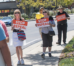 May 3, 2017 - Brea, CA, USA - Kari Moore, of Fullerton, from left, Charlene Swanner, of La Habra, and David Hansel, of Fullerton, were part of a small group of protesters who rallied and marched to Representative Ed Royce's office in Brea on Wednesday May 3, 2017 to urge Rep. Royce not to support the legislation to repeal and replace Obamacare. The group represented Organizing For Action.  (Photo by Ana Venegas, Orange County Register/SCNG) (Credit Image: © Ana Venegas, Ana Venegas/The Orange County Register via ZUMA Wire)