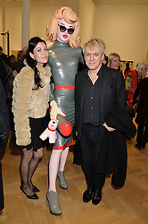 Left to right, NEFER SUVIO, PANDEMONIA and NICK RHODES at the opening private view of 'A Strong Sweet Smell of Incense - A portrait of Robert Fraser, held at the Pace Gallery, Burlington Gardens, London on 5th February 2015.