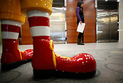 Students walk past a statue of Ronald McDonald at the McDonalds Hamburger University in Shanghai, China on Thursday, 13 january 2011.  McDonalds claim that the university's selection criteria is even more stringent than that of Harvard.