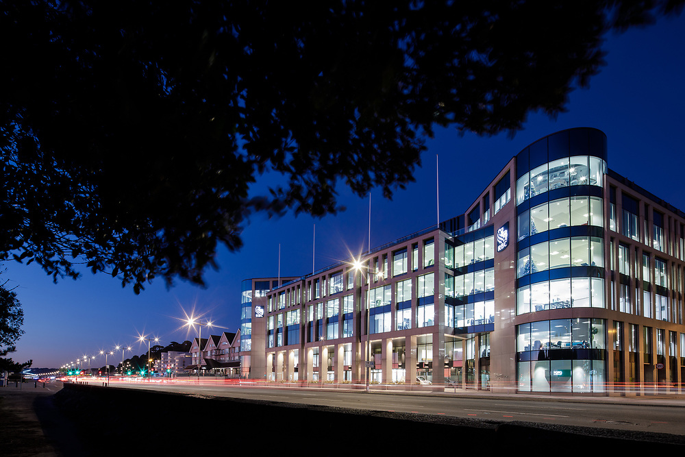 RBC corporate offices lit up at night along the Esplanade, the offshore banking and finance area of St Helier, Jersey, CI