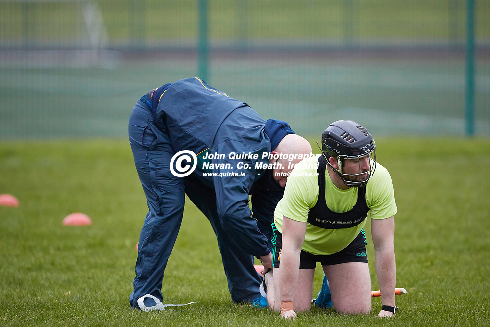 21-04-20, Meath Senior Hurling squad return to training at Dunganny<br /> Richie Daly helps Daragh Kelly during the first training session after the easing of the COVID-19 restrictions<br /> Photo: David Mullen / www.quirke.ie ©John Quirke Photography, Proudstown Road Navan. Co. Meath. 046-9079044 / 087-2579454.<br /> ISO: 4000; Shutter: 1/500; Aperture: 4;