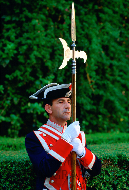 Ceremonial guard with spear at the Alcazar Palace in Seville, Spain