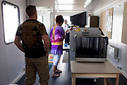 Visitors at HMP Kingston go through a security check and hacve their bags scanned. Portsmouth, United Kingdom. Kingston prison is a category C prison holding indeterminate sentenced prisoners.