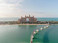 Aerial view of the luxurious Palm Jumeirah Atlantis Hotel and Monorail in Dubai, United Arab Emirates.