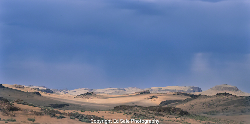 A thunderstorm over the desert in the Oywhee country of southeast Oregon creates a moon-like landscape
