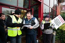PCS members and supporters in Sheffield stage an eight-hour demonstration to protest  against the planned closure of the local office of the Driver and Vehicle Licensing Agency (DVLA). The protest was called to coincide with a visit to the premises by transport minister Mike Penning.on Monday (23 January) but according to Mike Mackie, assistant secretary of the PCS northern branch for the DVLA, the visit was canceled within 15 minutes of the Sheffield Demo being announced on the PCS website..Mark Devlin collect a signature on the petion from a Local Office Customer.www.pauldaviddrabble.co.uk..23 January 2012 -  Image © Paul David Drabble