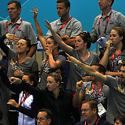 The USA swim team cheer Ryan Lochte, USA, winning the gold medal in the Men's 400m Individual Medley during the swimming finals at the Aquatic Centre at Olympic Park, Stratford during the London 2012 Olympic games. London, UK. 28th July 2012. Photo Tim Clayton