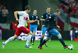 (R) England's Wayne Rooney fights for the ball with (L) Poland's Grzegorz Krychowiak (nr08) during the 2014 World Cup Qualifying Group H football match between Poland and England at National Stadium in Warsaw on October 17, 2012...Poland, Warsaw, October 17, 2012..Picture also available in RAW (NEF) or TIFF format on special request...For editorial use only. Any commercial or promotional use requires permission...Photo by © Adam Nurkiewicz / Mediasport