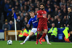 Everton's Lucas Digne (left) and Liverpool's Mohamed Salah battle for the ball during the Premier League match at Goodison Park, Liverpool.