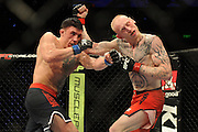 GOLD COAST, AUSTRALIA - DECEMBER 15: Norman Parke (L) punches Colin Fletcher during the Lightwieght final bout between Colin Fletcher and Norman Parke at Gold Coast Convention and Exhibition Centre on December 15, 2012 on the Gold Coast, Australia.  (Photo by Matt Roberts/Getty Images)