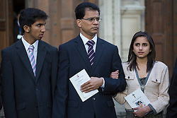 © licensed to London News Pictures. London, UK. 15/12/2012. The son Junal (left), husband Ben Barboza (centre) and The daughter Lisha (right), of nurse Jacinta Saldanha leaving Westminster Cathedral in London after a memorial service with Keith Vaz (not pictured) held for Jacinta Saldanha who committed suicide. Photo credit: Tolga Akmen/LNP