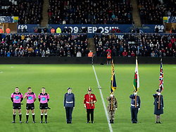 2nd November, Liberty Stadium , Swansea, Wales ; Guinness pro 14's Ospreys Rugby v Glasgow Warriors ;  Referee Andrew Brace, touch judges and flag bearers pay their respects before kick off<br /> <br /> Credit: Simon King/News Images<br /> <br /> Photographer Simon King/Replay Images<br /> <br /> Guinness PRO14 Round 8 - Ospreys v Glasgow Warriors - Friday 2nd November 2018 - Liberty Stadium - Swansea<br /> <br /> World Copyright © Replay Images . All rights reserved. info@replayimages.co.uk - http://replayimages.co.uk