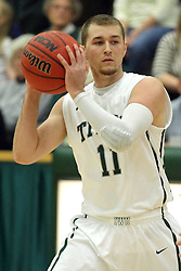 25 November 2014: Jordan Nelson  during an NCAA mens division 3 CCIW basketball game between the Milwaukee School of Engineering Raiders and the Illinois Wesleyan Titans in Shirk Center, Bloomington IL