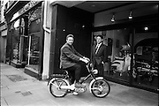 "26/06/1967<br /> 06/26/1967<br /> 26 June 1967<br /> Motoring Enthusiasts Week officially opened by Joe Lynch at the International Trade Promotion Centre, Dublin. Image shows Joe Lynch arriving at the International Trade Promotion Centre on the new Garelli ""Wasp"" and being greeted by Mr. Patrick McCarthy, Managing Director, Agrati Sales (Ireland) Ltd."