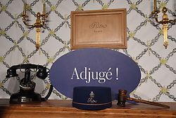 A groom's hat of the Ritz Paris, part of the 10,000 Ritz objects set to be auctioned by the Artcurial auction house is displayed on April 11, 2018 at Artcurial headquarters in Paris. The auction comes six years after the 159-bedroom hotel was closed for a four-year renovation project in 2012, with all of the objects coming from before the revamp.The sale which is scheduled to take place on April 17, 2018, will revisit the prestigious history of the Ritz Paris through the 3500 lots up for auction. Photo by Alain Apaydin/ABACAPRESS.COM