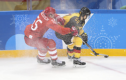 PYEONGCHANG, Feb. 25, 2018  Bogdan Kiselevich (L) of Olympic athletes from Russia vies for the puck with Patrick Hager of Germany during men's ice hockey final between Germany and Olympic athletes from Russia at Gangneung Hockey Centre, in Gangneung, South Korea, Feb. 25, 2018. The Olympic Athletes from Russia team defeated Germany 4:3 and won the gold medal. (Credit Image: © Han Yan/Xinhua via ZUMA Wire)