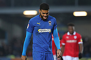 AFC Wimbledon striker Jake Jervis (10) walking off the pitch with his tongue out during the EFL Sky Bet League 1 match between AFC Wimbledon and Barnsley at the Cherry Red Records Stadium, Kingston, England on 19 January 2019.