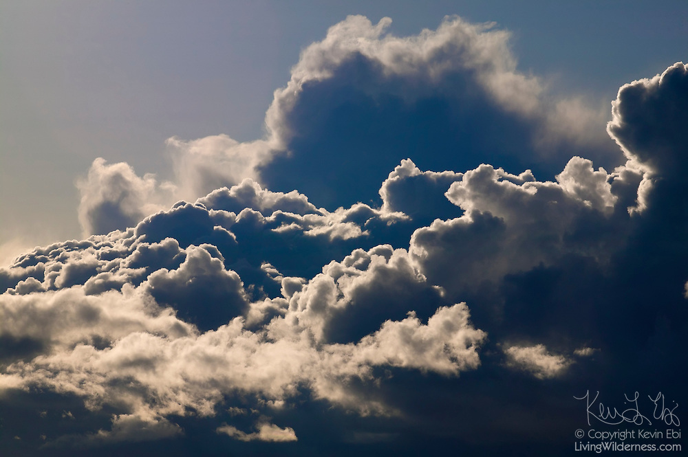 The afternoon sun highlights the texture of the towering cumulonimbus clouds over Puget Sound in Seattle, Washington.
