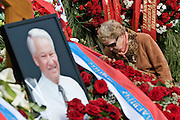 Moscow, Russia, 26/04/2007..Russians visit Boris Yeltsin's grave to pay their last respects after Novodevichy Cemetery was  reopened to the public on the day following the former Russian President's funeral. A woman arranges flowers at the grave..