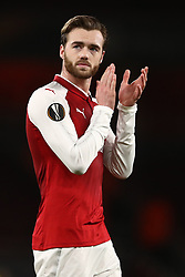 Arsenal's Calum Chambers applauds supporters after the final whistle