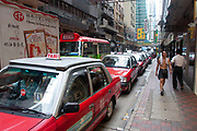Red taxis in a queue in Hong Kong, China.