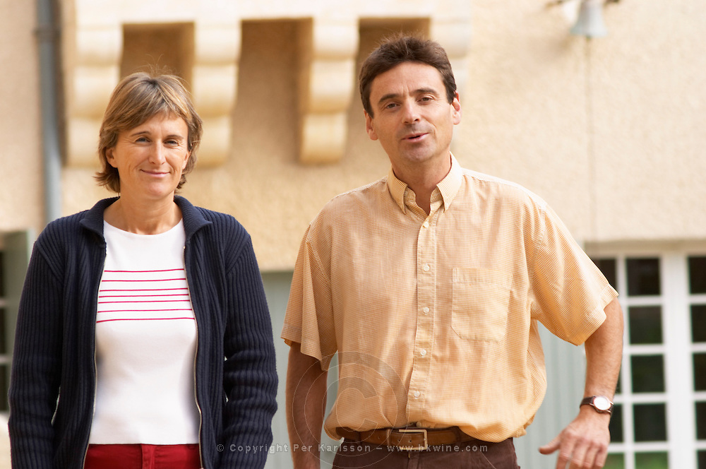 Francois and Anne Collard, owners and winemakers, in the courtyard in front of the symbolic sun dial.  Chateau Mourgues du Gres Grès, Costieres de Nimes, Bouches du Rhone, Provence, France, Europe