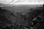 06-10/04/1964.04/06-10/1964.06-10 April 1964.Views on the River Shannon. Buckets of coal slip down the conveyor belt from the pit head at Arigna colleries Co. Roscommon.
