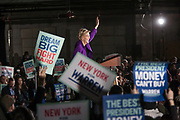 """Long Island City, NY – 8 March 2019. Massachusetts Senator and Democratic Presidential candidate Elizabeth Warren drew an enthusiastic crowd at an organizing rally for her 2020 presidential campaign in Long Island City. Enthusiastic supporters wave signs reading """"Dream Big Fight Hard"""" and """"The Best President Money Can't Buy."""""""