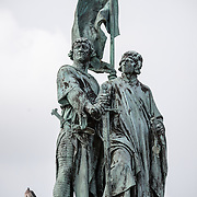 A statue of Jan Breydel and Pieter de Coninck in the Markt (Market Square) in the historic center of Bruges, a UNESCO World Heritage site. The two men, a weaver and a butcher, helped lead a Flemish rebellion against the occupying French in the Battle of the Golden Spurs on July 11, 1302.
